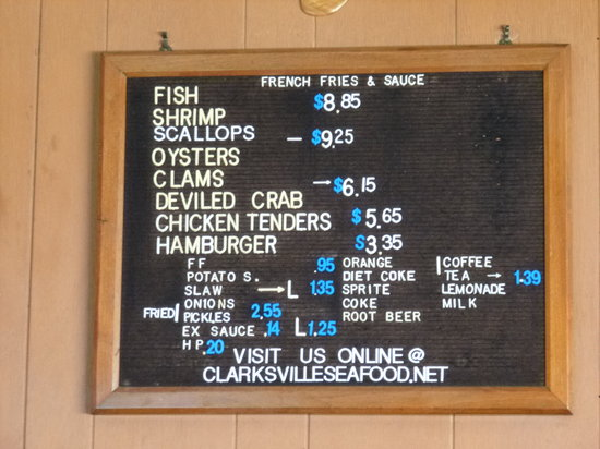 Clarksville Seafood INC: CSI's menu on wall