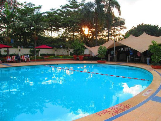 Nairobi International Youth Hostel: outdoor pool food and drink served