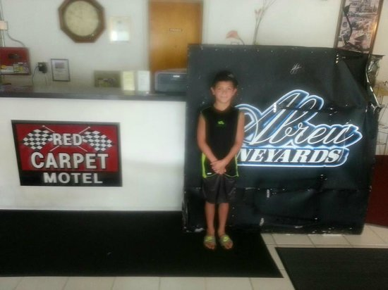 Red Carpet Motel - Knoxville: my son in the lobby with the wing he got from kyle larson