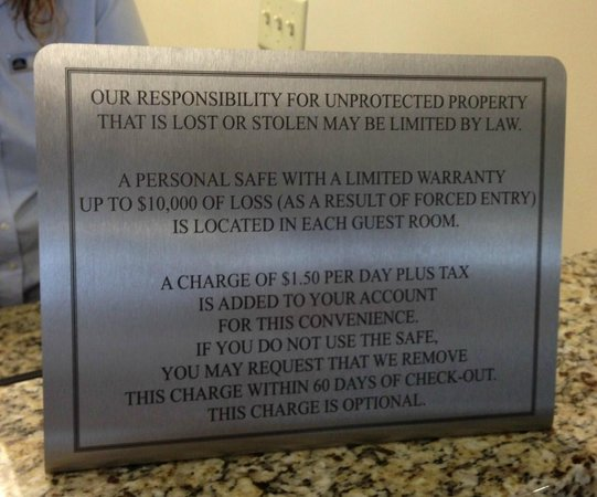 The Carbondale Grand Hotel & Conference Center: Front desk manditory safe charge sign
