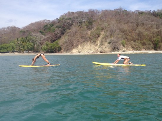 Water Dreams Costa Rica: Trying to do yoga on a SUP board!