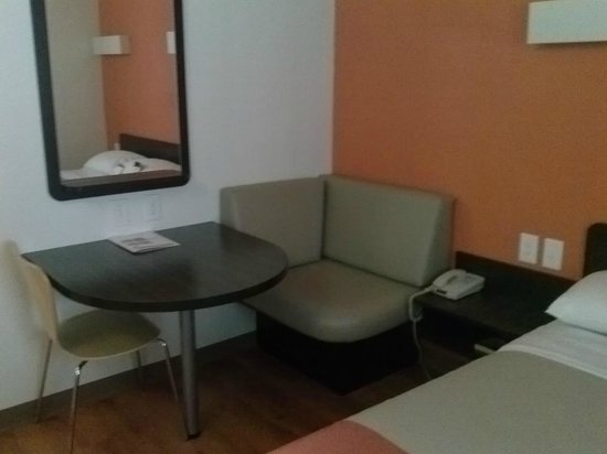 Motel 6 Sunnyvale North : Seating area.  More comfy than it looks.  Other side of the room has a microwave and mini fridge