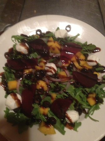 Yvonne's Cafe : Baby arugula with goat cheese, oven roasted red beets, mango, olives and red onions. Drizzled wi
