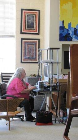 James-Ben: Studio & Gallery Art Center: JamesBen at his desk among all the art