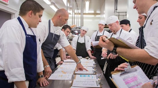 The Fearrington House Restaurant: Executive Chef Colin Bedford and team planning in kitchen