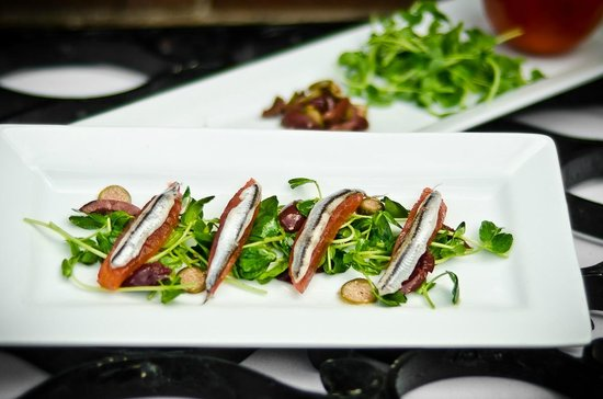 The Crossing: White anchovies with tomato, caper berries and pea shoots