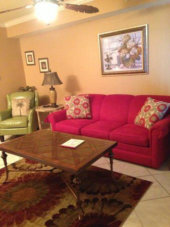 Four Winds Condominiums: Living Room Area with comfy new Red Sofa Sleeper and Kiwi Leather Chairs