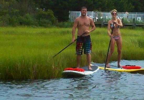 OC SUP & Fitness: Our instructor even balanced on her own board, in the middle of the water, while taking our phot