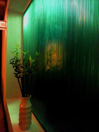 Edo: Feature Wall.  The light behind the thinly sliced green marble slabs calmingly refracts througho