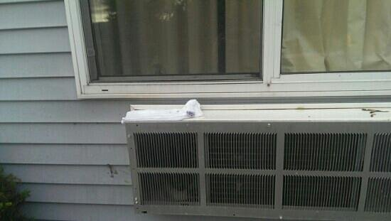 Super 8 Manistee: dripping water on air conditioner