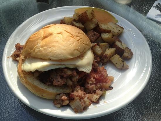 Barn: six gun on a bun sandwich. corn beef hash, eggs and salsa sandwich.