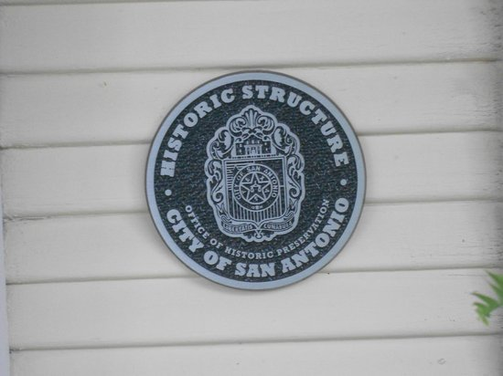 Eva's Escape at the Gardenia Inn: Official Historic Structure Badge on the front porch