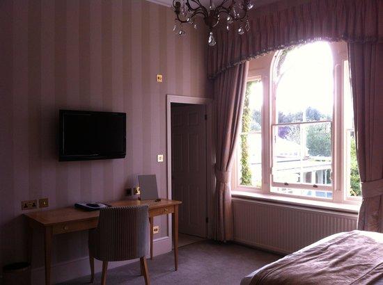 The Spa Hotel : view towards window with door to bathroom in corner