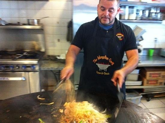 The Mongolian Grill: the chef cooking on the grill