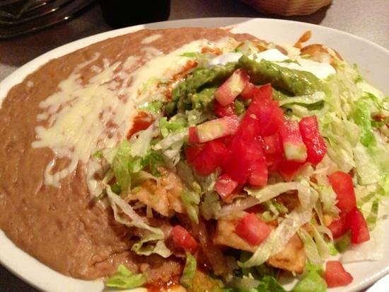 Salsitas Mexican Restaurant & Cantina: Chicken Chimichanga. it's under there really. It was great.
