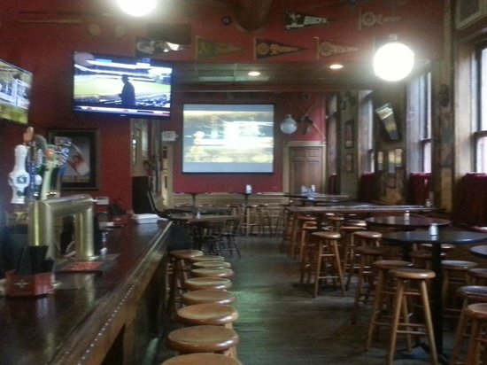 Upper 90 Sports Pub: 120 inch projection screen and vintage vibe