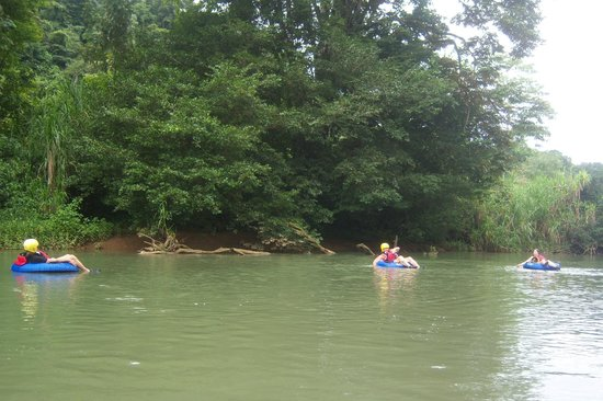 Dominical Surf Adventures: Floating on the Baru River - helmuts were necessary for going through the level one rapids.