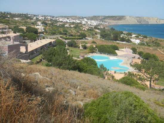 Porto Dona Maria Resort: View from the hill where the proposed hotel would be built.  Shows pool and Luz in the distance