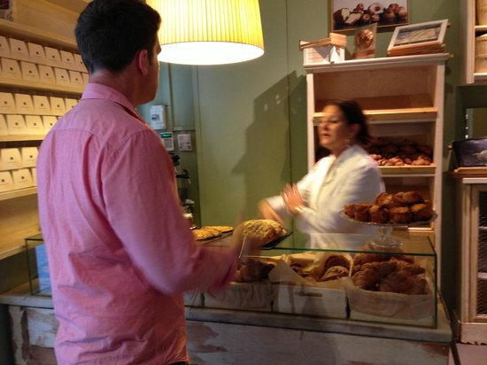 Pastisseria Hofmann: Making the purchase - note the golden croissant award in the background!