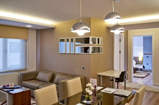 Aura Suites: Dining and living area of our 2-Bedroom Suite