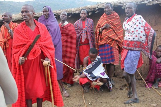 East Africa Adventure Tours and Safaris - Day Tours: Masai village- making fire