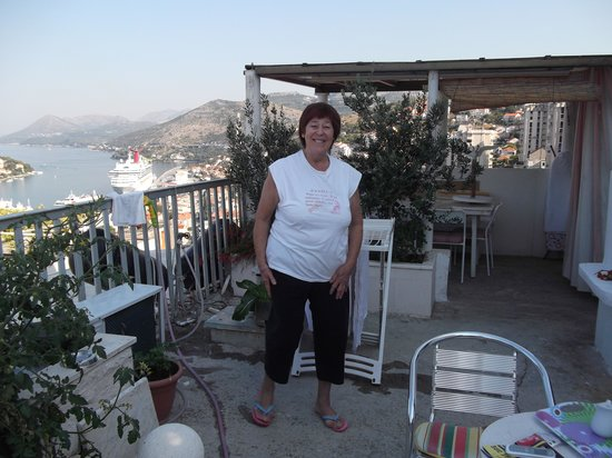 Sinistaj Rooms: Sonya on roof terrace.