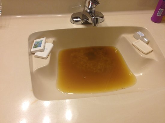 "Hotel Blue: Our sink after they came 3 times and ""fixed"" it"