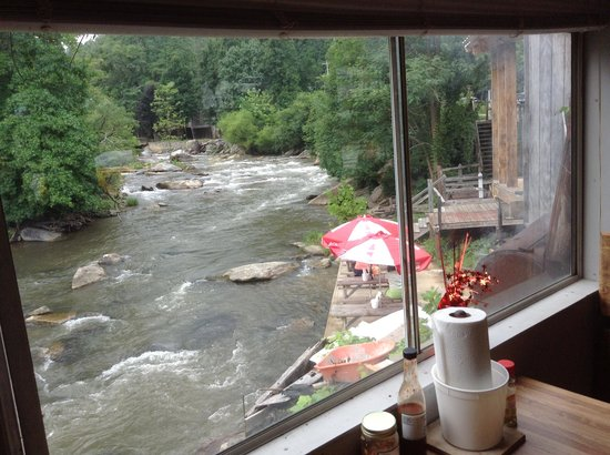 Duncan's Bar-B-Que: From inside looking out and down to outdoor riverside tables