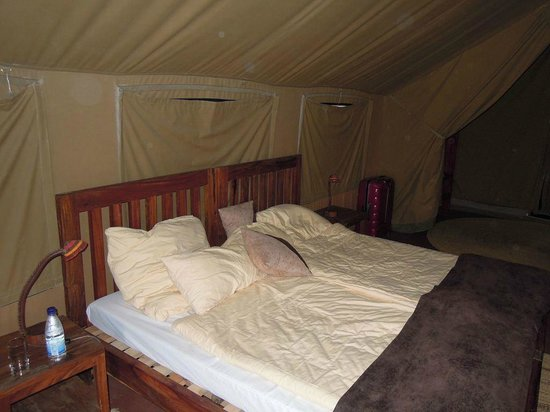 Bed inside the tent   Picture of Olduvai Camp, Serengeti National