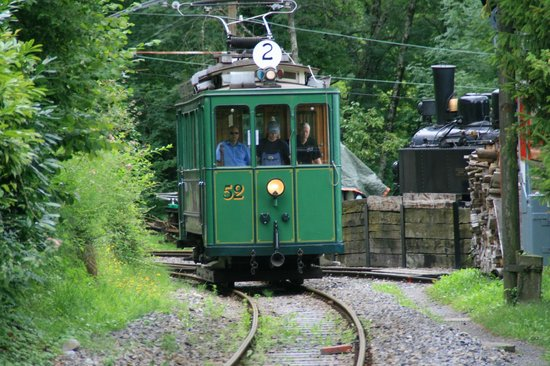 Railway Museum Blonay-Chamby: 100-year-old Berne tramcar squeals into the museum site past  German Mallet loco for the weekend