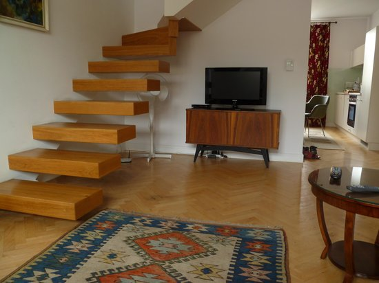 Crystal Suites: living room with stairs to bedroom