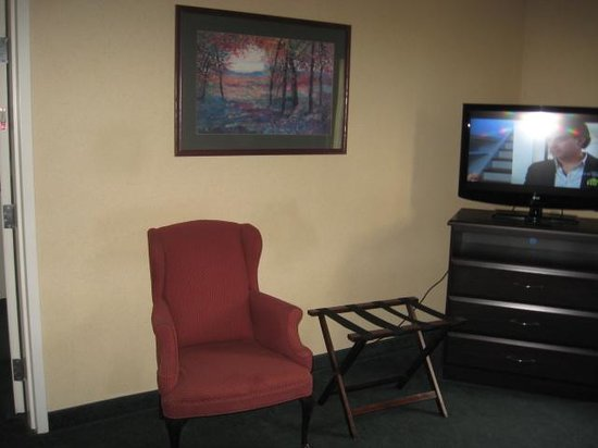 Quality Inn of Harrisonburg: Dirty looking dated worn out chair.  They also put the luggage stand in the living area, not in