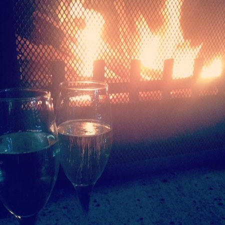 Spicers Vineyards Estate : A glass of wine by the in-room fire place