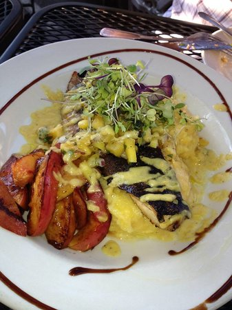 Yvonne's Cafe : Brazilian Tiger Fish served with a mango salsa and grilled peaches over polenta.
