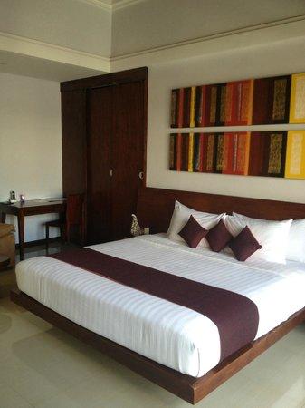 The Wolas Villas & Spa: Bedroom area (flatscreen tv out of shot)