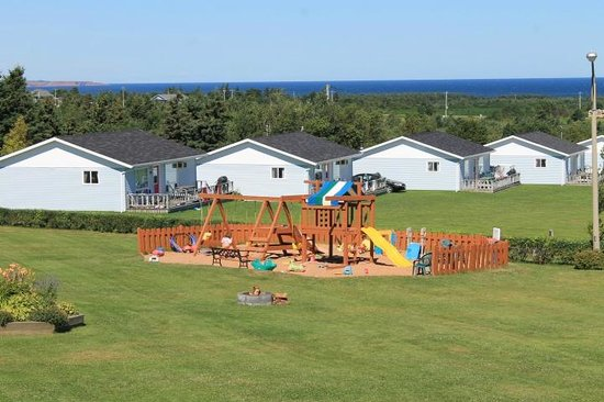 Cavendish Bosom Buddies Cottages and Suites : Playground with water in the background