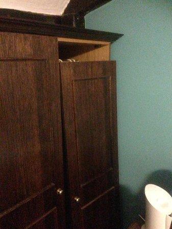 The George Inn: Wardrobe door hanging off