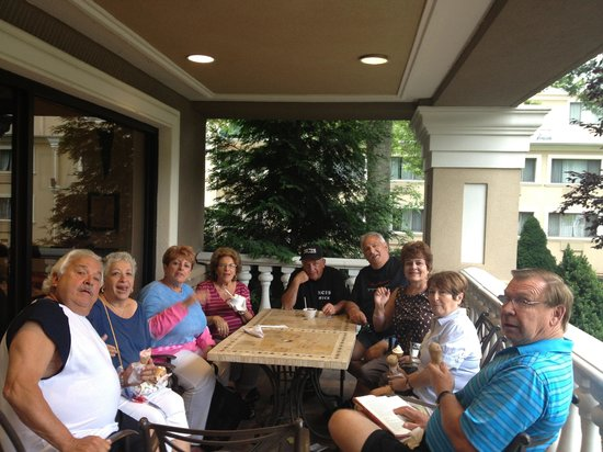Villa Roma Resort and Conference Center: Enjoying Ice Cream with our friends on the front balcony of the main building.
