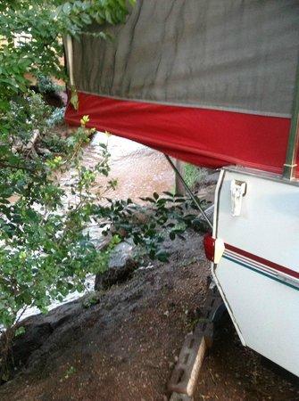 Pikes Peak RV Park & Campground: Pikes Peak RV Campsite along the stream.