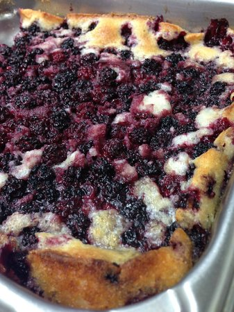 Old Rock Café: Locally picked, homemade Black Berry Cobbler! Served with a scoop of ice cream