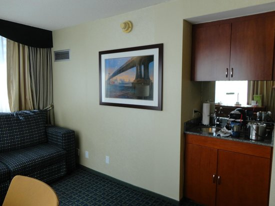 DoubleTree Suites by Hilton Hotel New York City - Times Square: Wet bar with the upper cabinet containing the microwave and safe