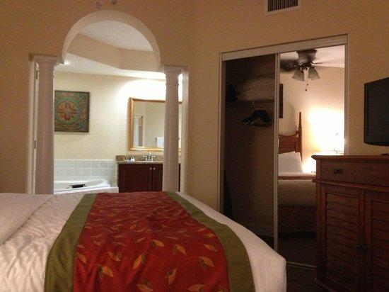 Grande Villas Resort: Master bedroom from patio door looking towards jetted tub and sink