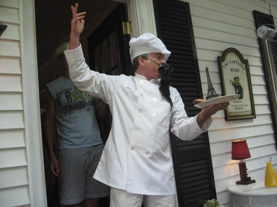 Captain David Kelley House: Tom presenting his scones with great fanfare as a French chef.