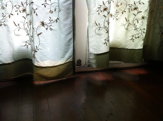The Jenner Inn : Stained curtains where the doors do not close and rain comes in