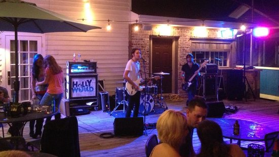The White Dog Bistro : Holly Would performing on the Outdoor Patio.