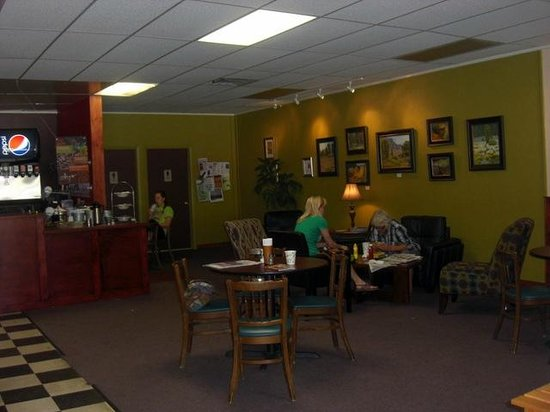 Midtown Cafe: Interior with comfy chairs and small tables