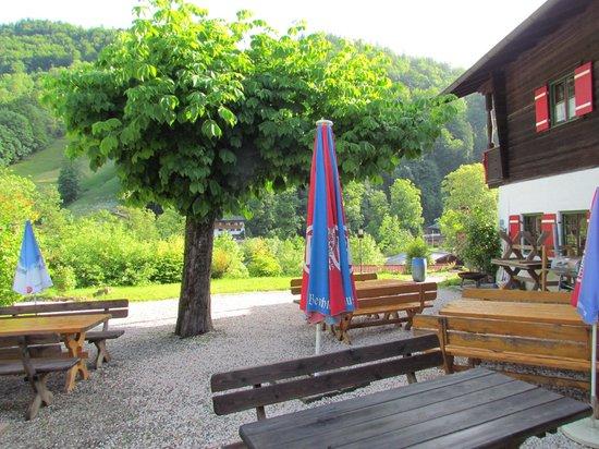 Wirtshaus Hocheck: Beer Garden with hotel in background