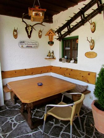 Wirtshaus Hocheck: Outside table, next to front door.