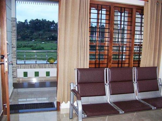 Villa Wayanad Holiday Homes: Living area