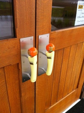 Bell's Comstock Brewery : Oberon tap handles used as door handles